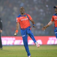Gujarat Lions' bowler Dwayne Bravo (L) and captain Suresh Raina celebrate after  the dismissal of Delhi Daredevils' batsman Jean-Paul Duminy  uring the 2016 Indian Premier League (IPL) T20 cricket match between Delhi Daredevils and Gujarat Lions at The Feroz Shaht Kotla Stadium in New Delhi  on April 27, 2016.  / AFP PHOTO / SAJJAD HUSSAIN / ----IMAGE RESTRICTED TO EDITORIAL USE - STRICTLY NO COMMERCIAL USE----- / GETTYOUT