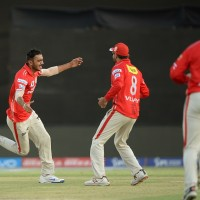 Kings XI Punjab Axar Patel (L) celebrates with teammates after taking the wicket of Gujarat Lions batsman Dwayne Bravo during the 2016 Indian Premier League (IPL) Twenty20 cricket match between Gujarat Lions and Kings XI Punjab at The Saurashtra Cricket Association Stadium in Rajkot on May 1, 2016.   GETTYOUT / ----IMAGE RESTRICTED TO EDITORIAL USE - STRICTLY NO COMMERCIAL USE----- / AFP PHOTO / PUNIT PARANJPE