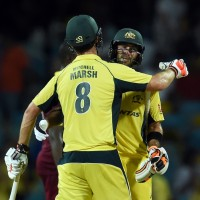 Australian cricketer Mitchell Marsh (#8) and his teammate Glenn Maxwell celebrate their vicoty during the 8th One Day International match of the Tri-nation Series between Australia and West Indies at the Kensington Oval stadium in Bridgetown on June 21, 2016. Australia defeated West Indies by 6 wickets to secure their place in the series final.  / AFP / Jewel SAMAD        (Photo credit should read JEWEL SAMAD/AFP/Getty Images)
