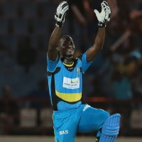 21 July 2016; Darren Sammy celebrates his 50 infront his home crowd during Match 21 of the Hero Caribbean Premier League match between the St Lucia Zouks and the Nevis Patriots at the Daren Sammy Cricket Stadium, Gros Islet, St Lucia.  Photo by Ashley Allen/Sportsfile