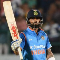virat-kohli-raises-his-bat-after-completing-a-half-century-50-runs-during-the-first