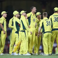 SYDNEY, AUSTRALIA - DECEMBER 04:  The Australian team watch the replay on the big screen after Josh Hazlewood of Australia took the wicket of Colin de Grandhomme of New Zealand leg before wicket during game one of the One Day International series between Australia and New Zealand at Sydney Cricket Ground on December 4, 2016 in Sydney, Australia.  (Photo by Mark Kolbe/Getty Images)